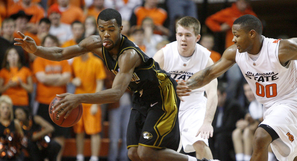 OSU\'s Keiton Page, and Byron Eaton, right, chase aftr Missouri\'s Zaire Taylor during the Big 12 college basketball game between Oklahoma State and Missouri at Gallagher-Iba Arena in Stillwater, Okla., Wednesday, Jan. 21, 2009. PHOTO BY BRYAN TERRY, THE OKLAHOMAN