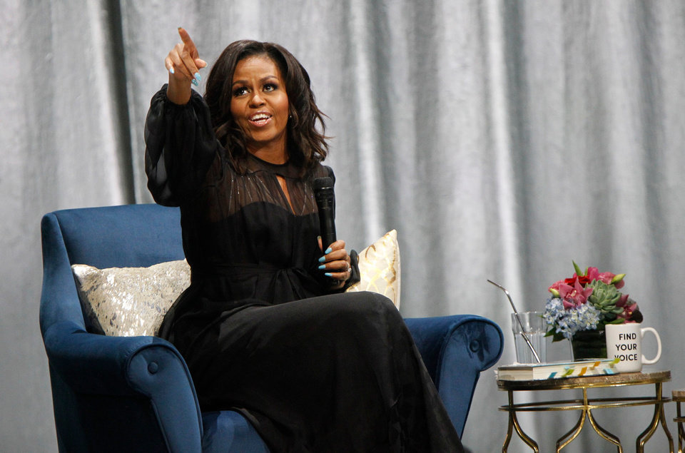 Photo - Former first lady Michelle Obama acknowledges an audience member during her  'A Conversation with Michelle Obama' at the Miller Life Theatre on March 14. Comedian Conan O'Brien was the moderator for the event.  Mjs Michelle 3