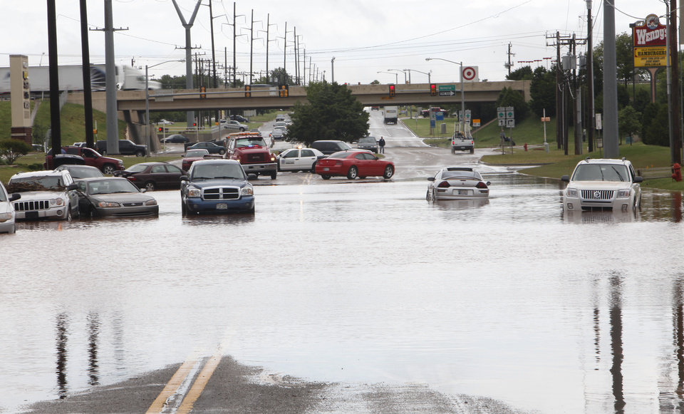 Cars sit in water on Pennsylvania just south of Memorial, Monday,  June 14, 2010.    Photo by David McDaniel, The Oklahoman