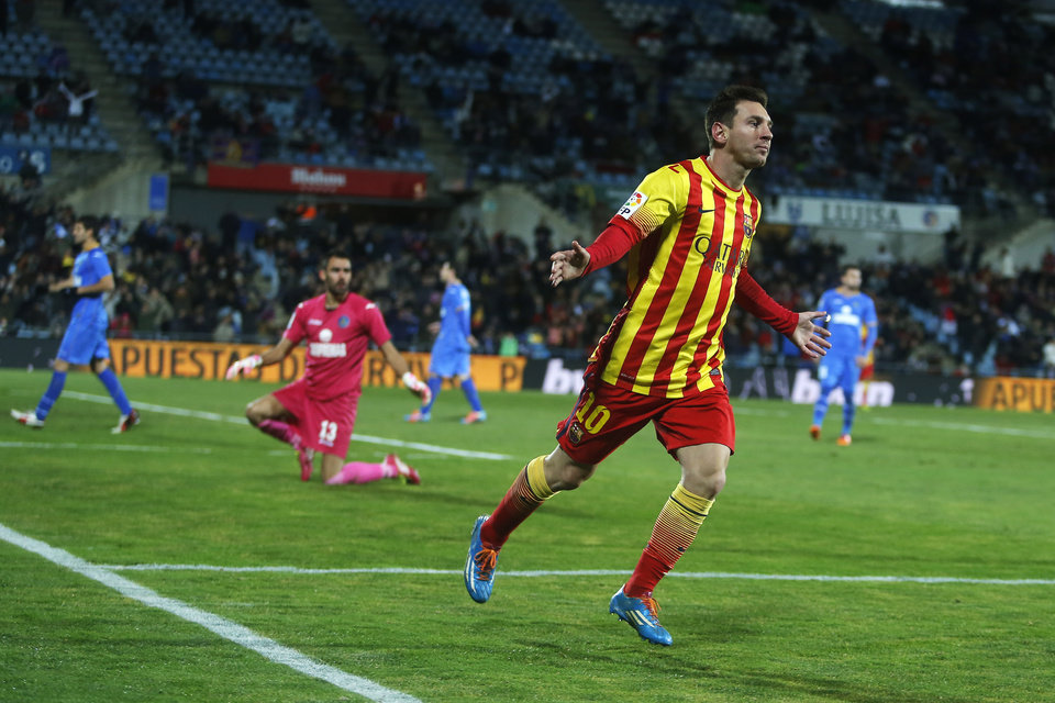 Photo - Barcelona's Lionel Messi celebrates his goal during a Spanish Copa del Rey match between FC Barcelona and Getafe at the Coliseum Alfonso Perez stadium in Madrid, Spain, Thursday, Jan. 16, 2014. (AP Photo/Andres Kudacki)
