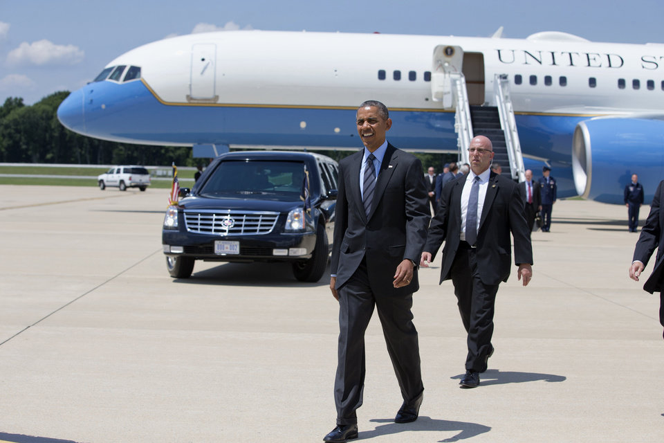 Photo - President Barack Obama arrives at New Castle Air National Guard Base in New Castle, Del., Thursday, July 17, 2014, en route to Wilmington where he is expected to visit the site of the damaged I-495 bridge in Wilmington to speak about transportation and infrastructure. (AP Photo/Jacquelyn Martin)