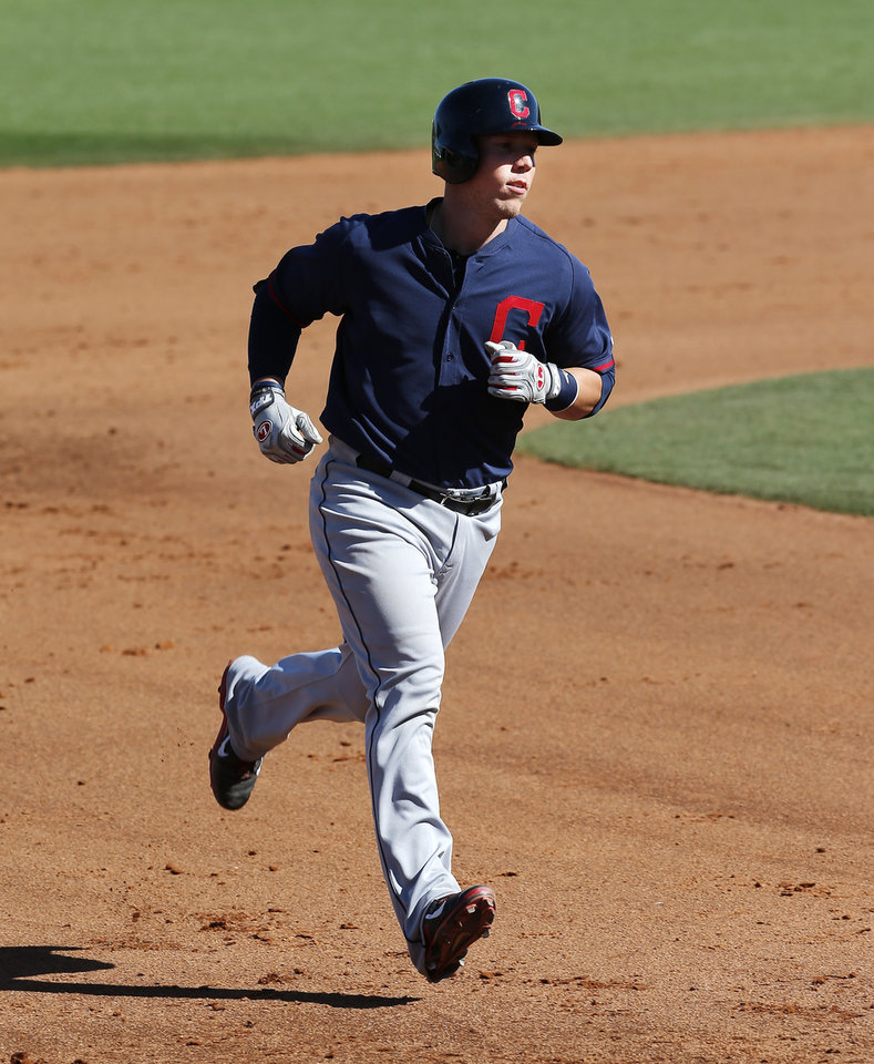 Photo - Cleveland Indians' Jake Lowery rounds the bases after hitting a grand slam in the fifth inning of an exhibition baseball game against the Cincinnati Reds in Goodyear, Ariz., Thursday, Feb. 27, 2014. (AP Photo/Paul Sancya)