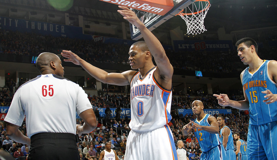 Oklahoma City Thunder point guard Russell Westbrook (0) complains to the official about a foul during the NBA basketball game between the Oklahoma City Thunder and the New Orleans Hornets at the Chesapeake Energy Arena on Wednesday, Jan. 25, 2012, in Oklahoma City, Okla. Photo by Chris Landsberger, The Oklahoman