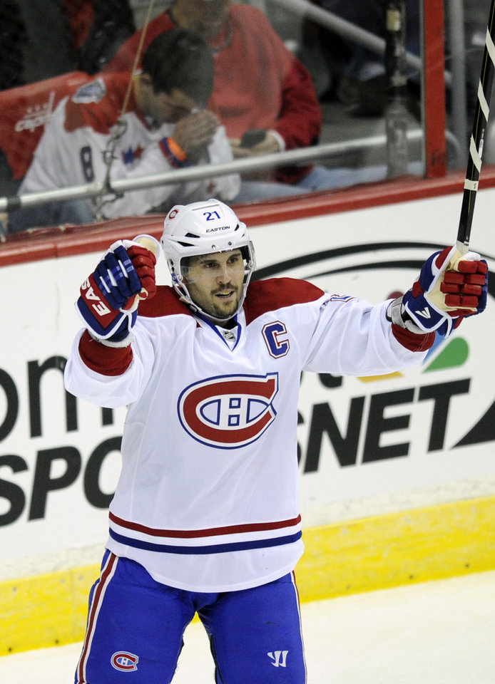 Montreal Canadiens right wing Brian Gionta (21) celebrates his goal during the second period of an NHL hockey game against the Washington Capitals, Thursday, Jan. 24, 2013, in Washington. (AP Photo/Nick Wass)