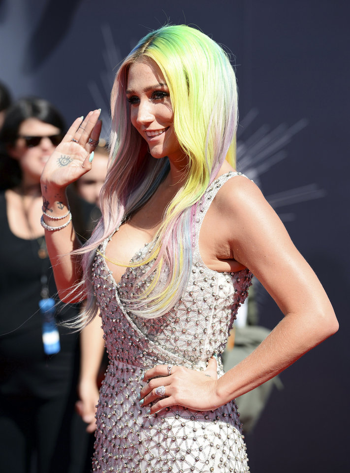 Photo - Kesha arrives at the MTV Video Music Awards at The Forum on Sunday, Aug. 24, 2014, in Inglewood, Calif. (Photo by Jordan Strauss/Invision/AP)