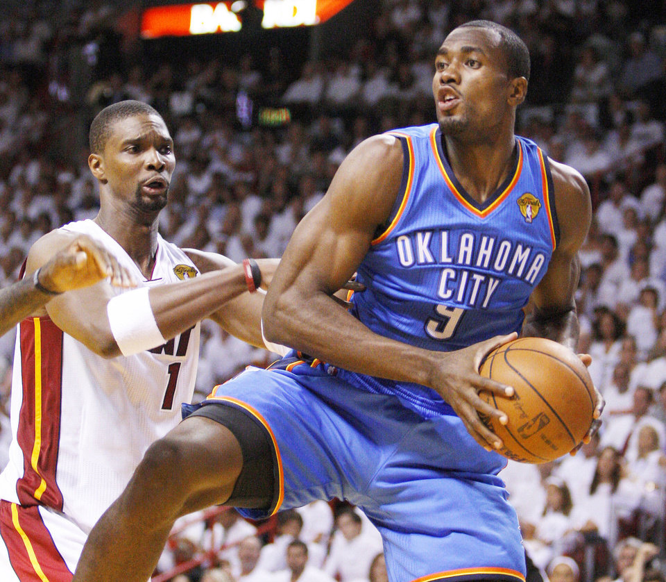 Photo - Oklahoma City's Serge Ibaka, right, grabs the ball beside Miami's Chris Bosh during Tuesday's Game 4 of the NBA Finals. Ibaka gave teammate James Harden a pep talk on Wednesday. Photo by Bryan Terry, The Oklahoman