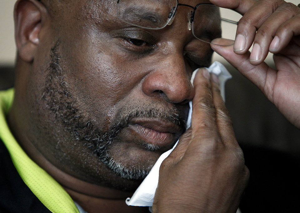 Kenneth Cherry Sr. wipes his face during a news conference in Las Vegas on Saturday, Feb. 23, 2013, regarding the death of his son Kenny Cherry. Kenneth Cherry Jr., was driving a Maserati that was peppered by gunfire before it sped through a red light and smashed into a taxi driven by Michael Boldon carrying passenger Sandra Sutton-Wasmund. All three involved in the crash were killed and the  coroner said Cherry died of a gunshot to the chest. (AP Photo/Las Vegas Review-Journal, John Locher)
