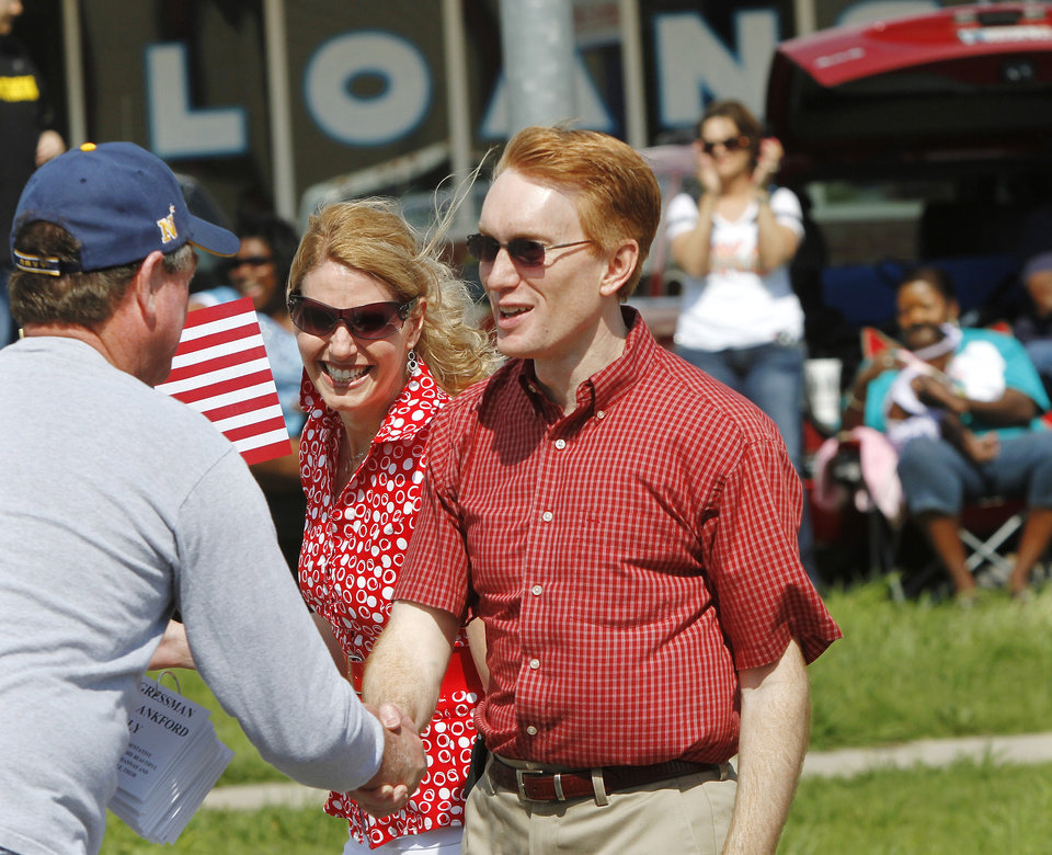 US Congressman James Lankford, representing Oklahoma's fifth congressional district,  and his wife, Cindy, greet people along the parade route. Lankford and his wife walked and shook hands with constituents  who lined the streets to see the parade. Del City and eastern Oklahoma County residents lined S. Sunnylane Road  to show their support for America's military,  applauding and cheering  participants who marched and rode in the city's Armed Forces Day Parade on Saturday morning, May, 19, 2012. The parade worked its way along the Del City route for a little more than an hour.  Photo by Jim Beckel, The Oklahoman