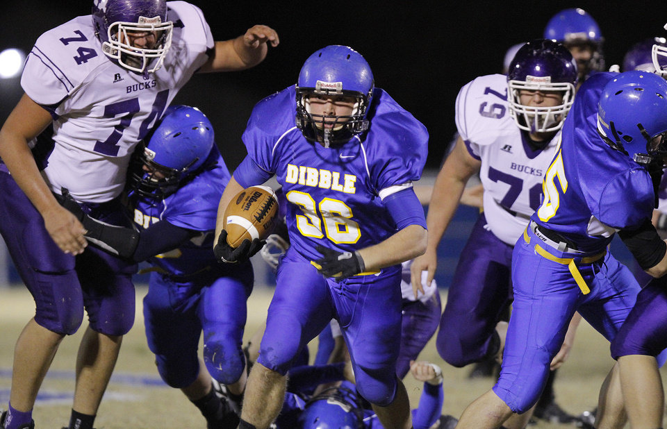 Dibble's Tazden Javons (36) through the Hominy defense during the high school football playoff game between Dibble High School and Hominy High School at Dibble High School on Friday, Nov. 18, 2011. in Dibble, Okla.  Photo by Chris Landsberger, The Oklahoman