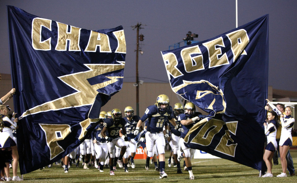 Photo - Heritage Hall takes to the field before the high school football game between Heritage Hall and Bethany at Heritage Hall in Oklahoma City, Friday, Oct. 28, 2011. Photo by Sarah Phipps, The Oklahoman
