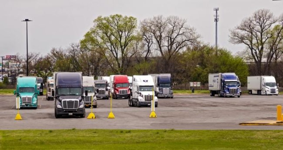 Photo -  Plenty of open spaces are seen in a truck stop parking area at the TA Travel Center at Morgan Road at Interstate 40, reflecting what one driver tells The Oklahoman is a sign of some drivers ending their routes due to risks posed by the COVID-19 pandemic. [Chris Landsberger/The Oklahoman]