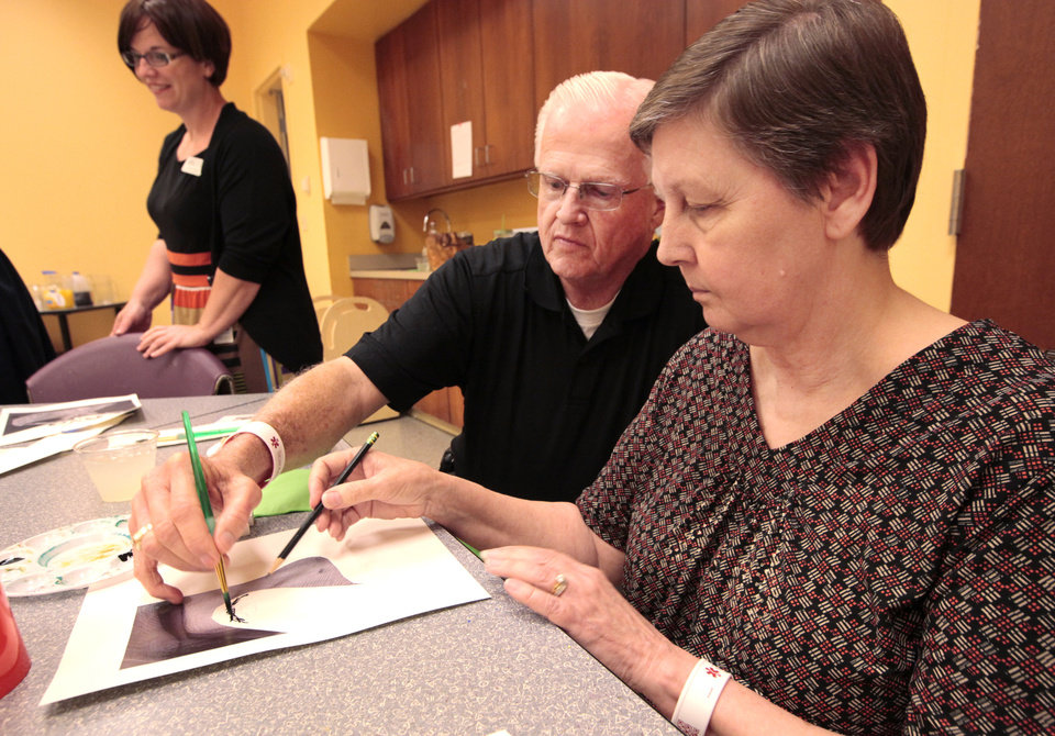 Photo - Joe Wackerly helps his wife, Johnna, a dementia patient, with her art project during a special event at the Oklahoma City Museum of Art. Photo by David McDaniel, The Oklahoman  David McDaniel - The Oklahoman