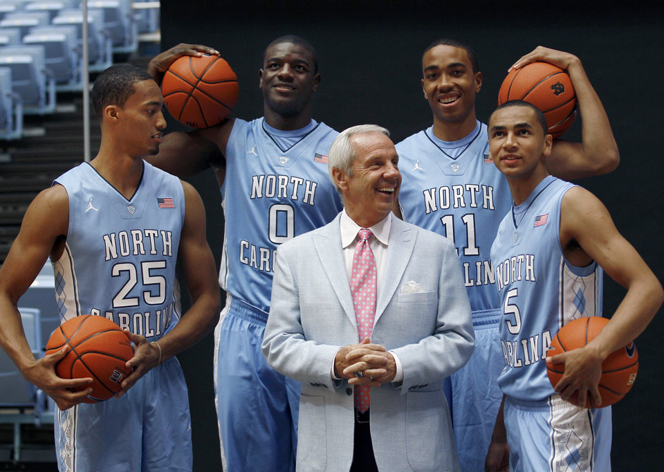 North Carolina coach Roy Williams speaks with freshman players J.P. Tokoto (25), Joel James (0), Brice Johnson (11) and Marcus Paige (5) during the team's NCAA college basketball media day in Chapel Hill, N.C., Thursday, Oct. 11, 2012. (AP Photo/Gerry Broome)