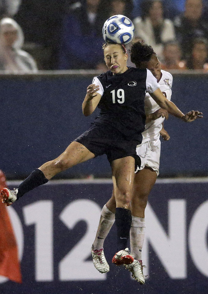 Photo - Penn State's Taylor Schram, left, and Florida State's Ines Jaurena vie for a header during the second half in an NCAA women's college soccer tournament semifinal, Friday, Nov. 30, 2012, in San Diego. Penn State won 2-1 in overtime. (AP Photo/Gregory Bull)