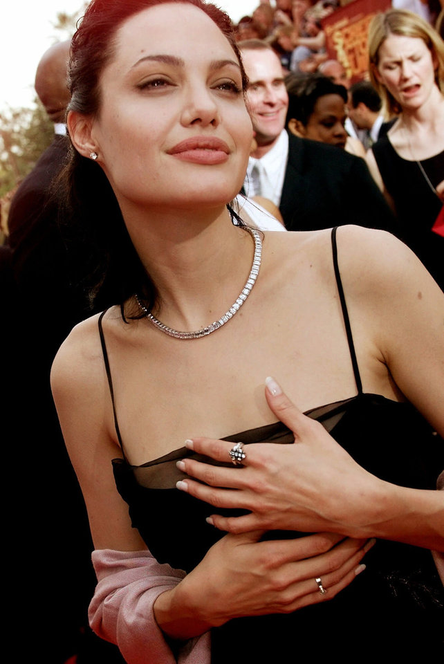 Photo - FILE - In this March 12, 2000 file photo, Actress Angelina Jolie arrives at the 6h Annual Screen Actors Guild Awards in Los Angeles. Jolie won an award for Outstanding Performance for a Female Actor in a Supporting Role for