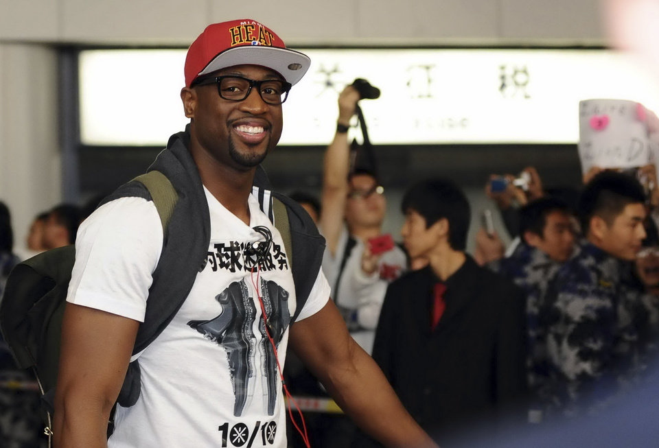 In this photo taken Monday Oct. 8, 2012, Dwyane Wade of the Miami Heat arrives at the airport in Beijing. The Miami Heat and the Los Angeles Clippers will play two preseason NBA games in China this week. (AP Photo/Osports) CHINA OUT