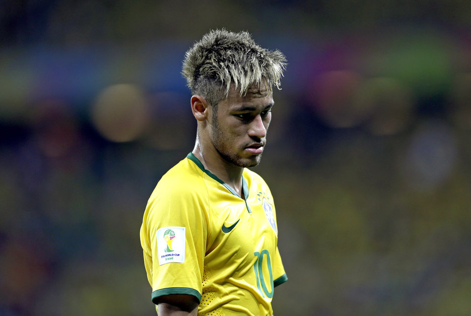 Photo - Brazil's Neymar looks down during the group A World Cup soccer match between Brazil and Mexico at the Arena Castelao in Fortaleza, Brazil, Tuesday, June 17, 2014. (AP Photo/Andre Penner)
