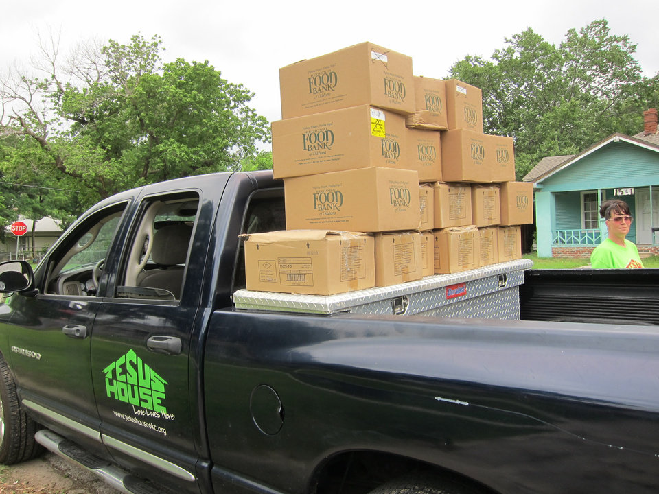 Photo - A Jesus House truck is loaded with boxes of food that will be distributed during the Jesus House's Adopt-A-Block program on Saturday mornings.