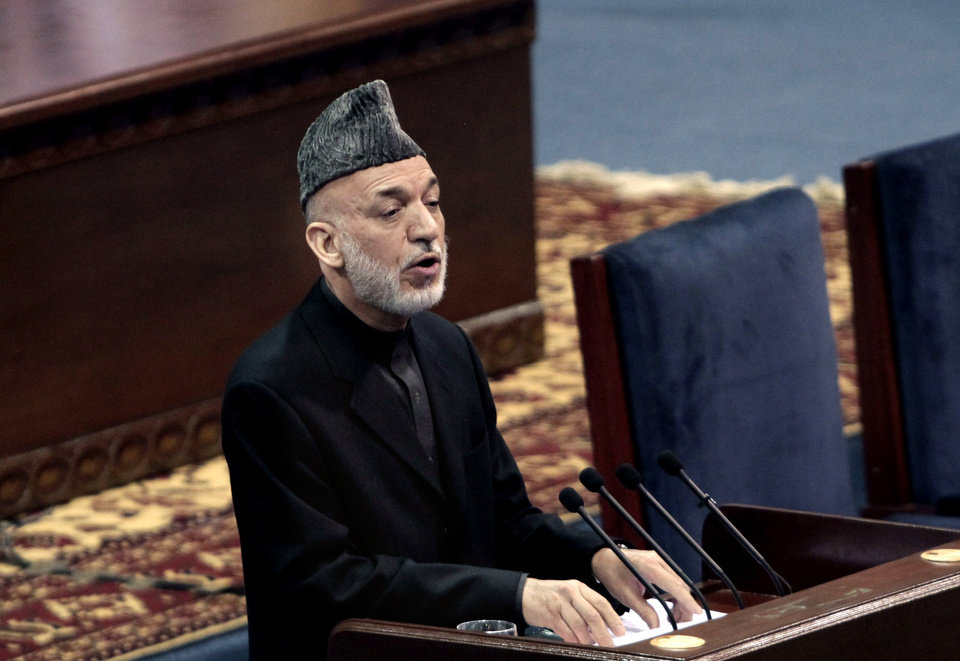 Photo - Afghan President Hamid Karzai speaks during the first day of the Loya Jirga in Kabul, Afghanistan, Thursday, Nov. 21, 2013. Karzai has told a gathering of elders that he supports signing a security deal with the United States if safety and security conditions are met. Karzai spoke as the 2,500-member national consultative council of Afghan elders known as the Loya Jirga started in Kabul on Thursday. The four-day meeting will discuss the bilateral security pact that defines the role of thousands of U.S. troops who will remain after the NATO combat mission ends in 2014. (AP Photo/Rahmat Gul)