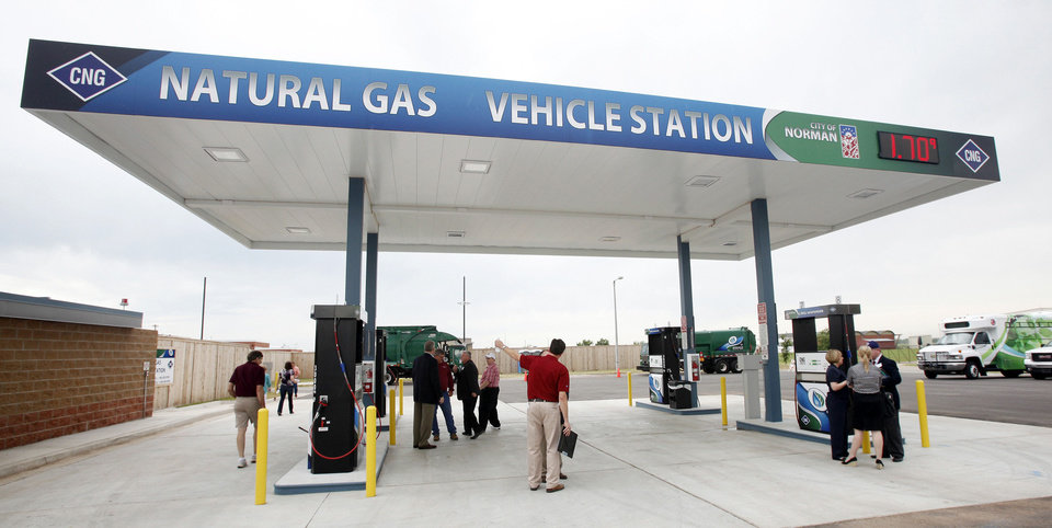 Norman officials and guests look over the fast-fill pump area of the city's new compressed natural gas fueling station Friday at its grand opening. PHOTO BY PAUL B SOUTHERLAND, THE OKLAHOMAN <strong>PAUL B. SOUTHERLAND</strong>