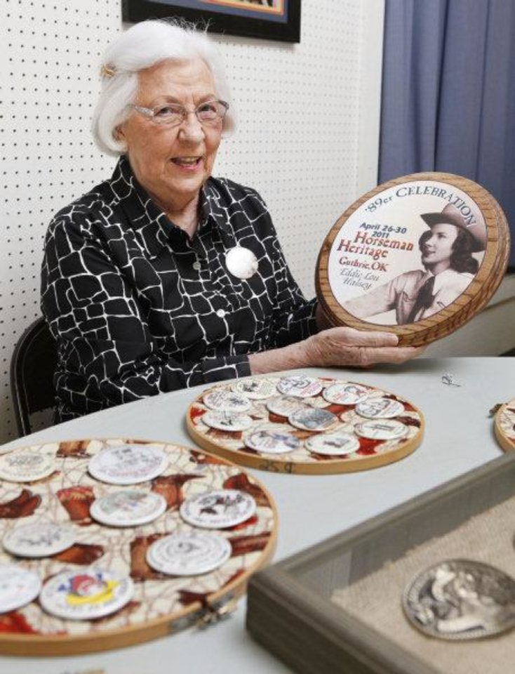 Photo - Eddie Lou Halsey holds a plague bearing a picture of her in 1939, the year she was 89er Queen. The plague, fashioned after this year's 89er Day button, will be auctioned off along with other commemorative buttons to raise money for the annual parade. PHOTO BY PAUL HELLSTERN, THE OKLAHOMAN