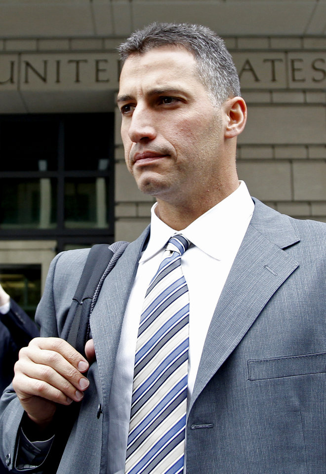 Photo -   Former Major League baseball pitcher Andy Pettitte leaves the Federal Court in Washington, Wednesday, May 2, 2012, after testifying in Roger Clemens; trial. Pettitte acknowledged under cross-examination Wednesday that he might have misunderstood Roger Clemens when Pettitte said he heard his former teammate say he used human growth hormone. (AP Photo/Haraz N. Ghanbari)