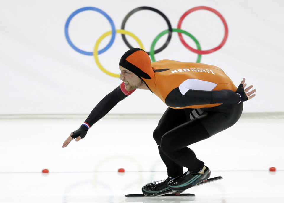 Photo - Gold medallist Michel Mulder of the Netherlands skates his way to gold during the second heat of the men's 500-meter speedskating race at the Adler Arena Skating Center at the 2014 Winter Olympics, Monday, Feb. 10, 2014, in Sochi, Russia. (AP Photo/Patrick Semansky)