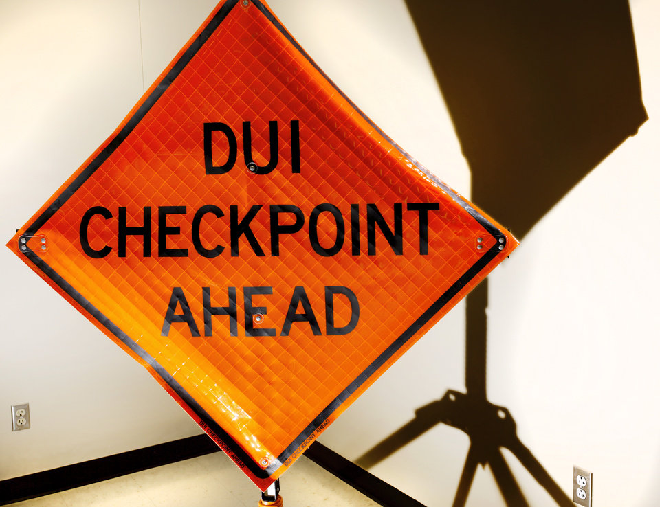 Photo -  A DUI checkpoint sign is shown at Oklahoma Highway Patrol's Troop A headquarters in southwest Oklahoma City. [Photo by Jim Beckel, The Oklahoman]