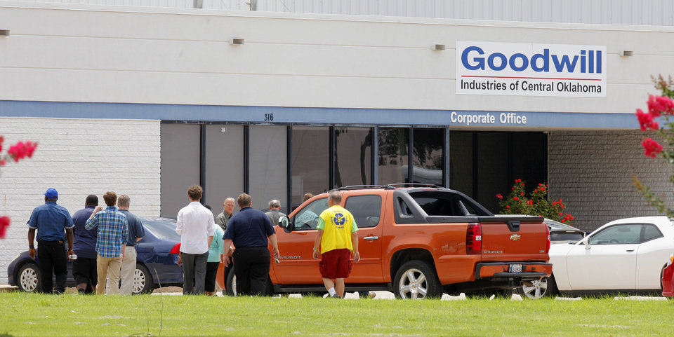 Photo - Employees return to work at Goodwill Industries, at 316 S Blackwelder Ave., after evacuating the building due to a bomb scare over two grenades found there in Oklahoma City Thursday, June 26, 2014.  Photo by Paul B. Southerland, The Oklahoman