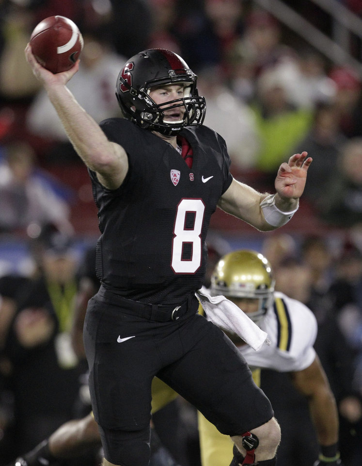 Photo - Stanford quarterback Kevin Hogan throws against UCLA during the first half of the Pac-12 championship NCAA college football game in Stanford, Calif., Friday, Nov. 30, 2012. (AP Photo/Tony Avelar)