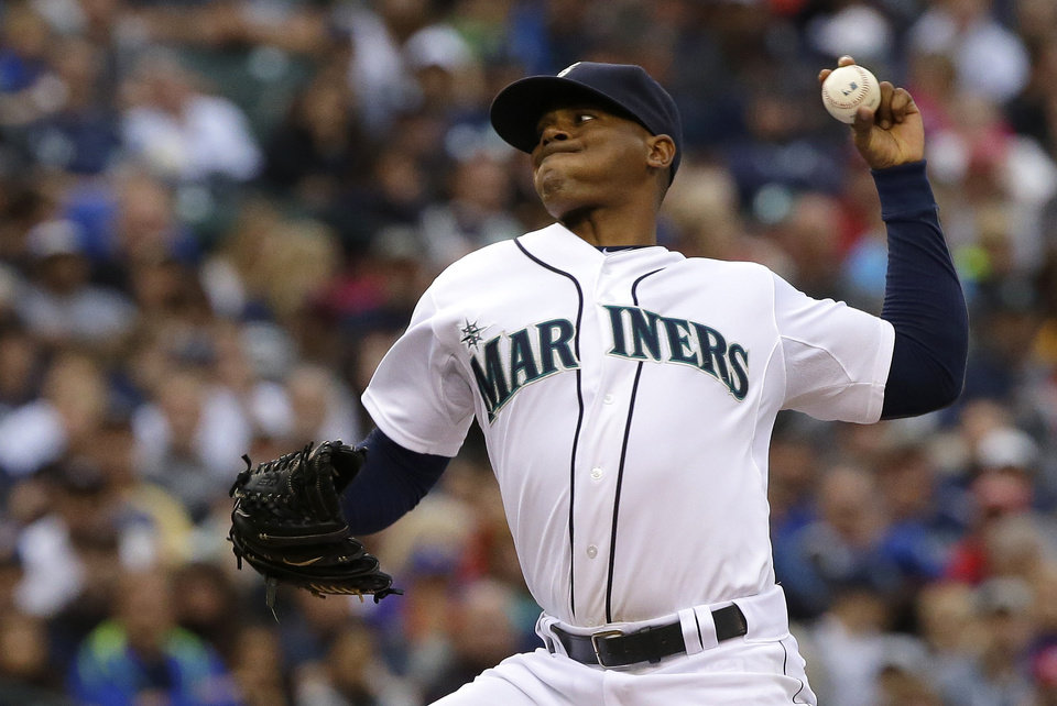 Photo - Seattle Mariners starting pitcher Roenis Elias kicks throws against the Washington Nationals during the fourth inning of a baseball game, Saturday, Aug. 30, 2014, in Seattle. (AP Photo/Ted S. Warren)