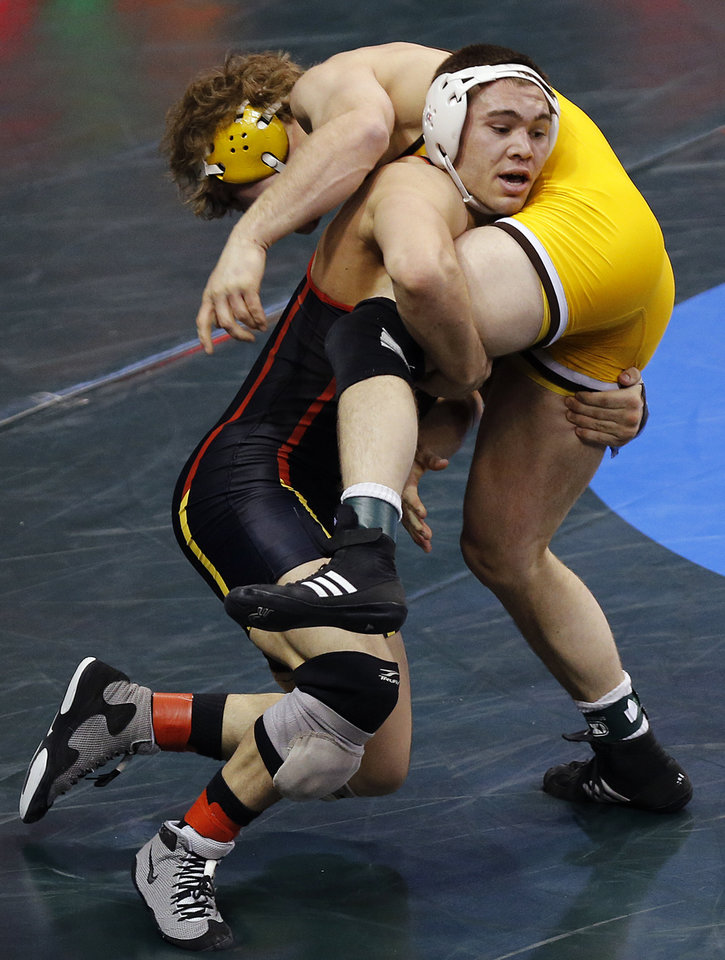 Photo - Maryland's Jimmy Sheptock takes on Wyoming's Benjamin Stroh in the 184 pound match during the 2014 NCAA Div. 1 Wrestling Championships at Chesapeake Energy Arena in Oklahoma City, Okla. on Thursday, March 20, 2014. Photo by Chris Landsberger, The Oklahoman