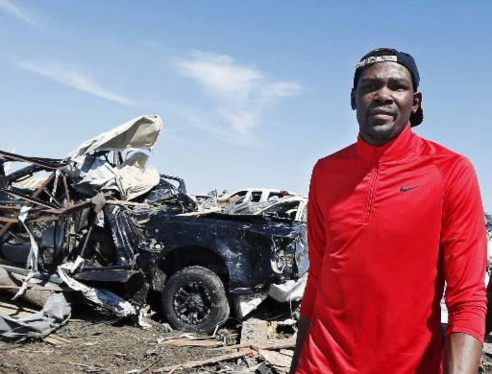 Four-time All-Star Kevin Durant toured the devastation in Moore on Thursday. (Photo by Jim Beckel, The Oklahoman.)