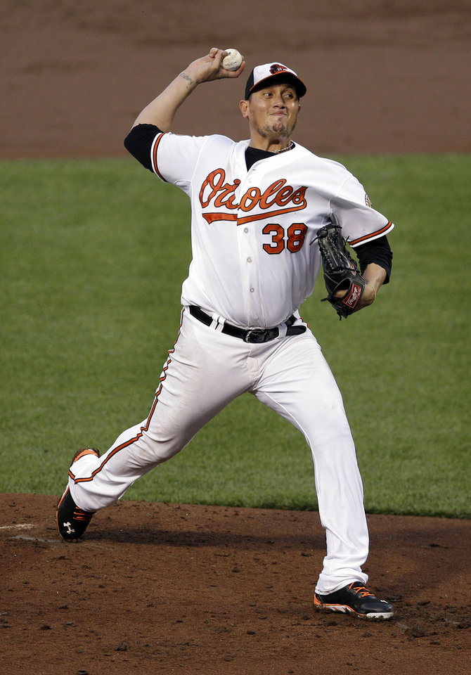 Photo - Baltimore Orioles starting pitcher Freddy Garcia throws to the New York Yankees in the third inning of a baseball game in Baltimore, Monday, May 20, 2013. (AP Photo/Patrick Semansky)