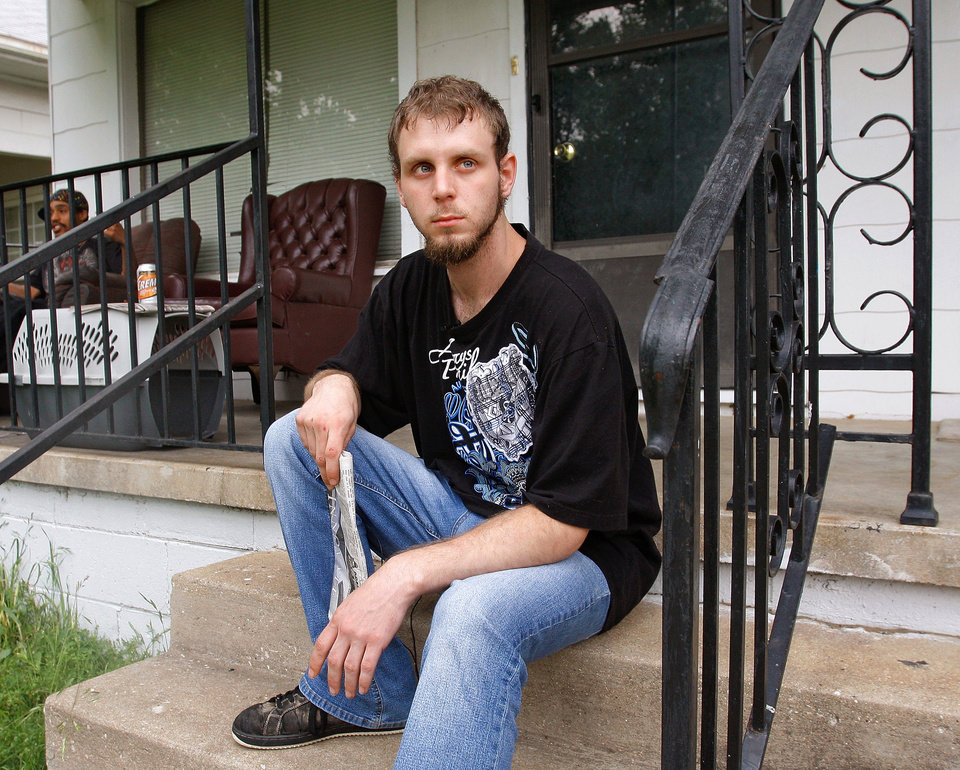 Photo - Ricky Prindle on the front porch of his Ada residence on Wednesday, May 11, 2011.  Prindle described in detail  the events of this past weekend where partygoers at a house on SH 9A about eight miles north of Konowa overdosed on 2C-E, a designer drug similar to ecstacy, sending several people to the hospital and killing one girl.  Prindle made the 911 call to authorities and helped take care of the overdose victims until medical aid arrived.   Photo by Jim Beckel, The Oklahoman