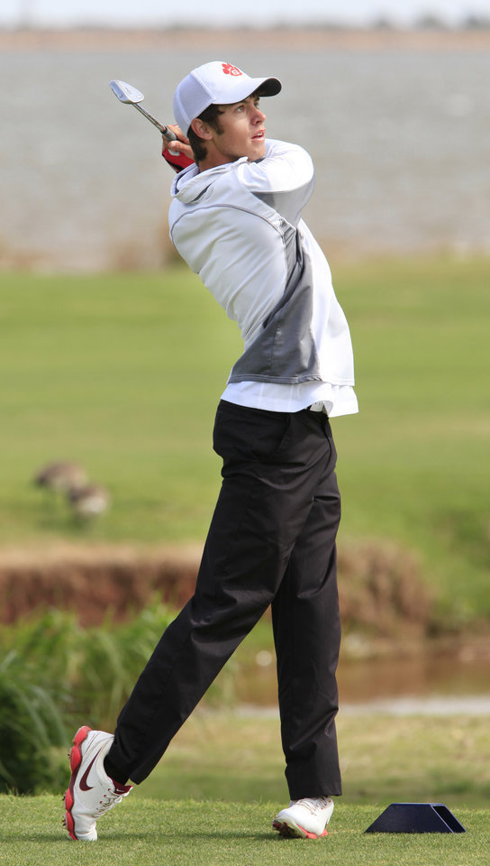 Photo - Wesley Jackson, Fort Gibson, tees off during the Class 4A boys golf at Lake Hefner Golf Course, Tuesday May 13, 2014.  Photo by David McDaniel, The Oklahoman