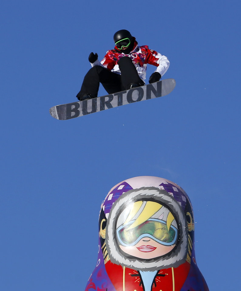 Photo - Canada's Mark McMorris takes a jump during the men's snowboard slopestyle semifinal at the Rosa Khutor Extreme Park, at the 2014 Winter Olympics, Saturday, Feb. 8, 2014, in Krasnaya Polyana, Russia. (AP Photo/Sergei Grits)