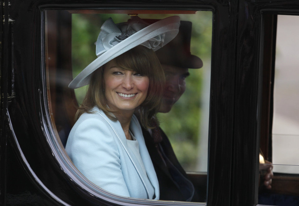 Photo - Carole, left, and Michael Middleton, Kate Middleton's parents, leave Westminster Abbey at the Royal Wedding in London Friday, April 29, 2011. (AP Photo/Alastair Grant)  ORG XMIT: RWFO161