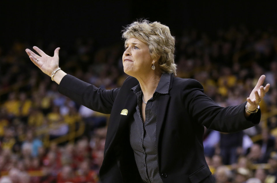 Photo - Iowa head coach Lisa Bluder reacts to a call during the first half of an NCAA tournament second-round women's college basketball game against Louisville, Tuesday, March 25, 2014, in Iowa City, Iowa. (AP Photo/Charlie Neibergall)