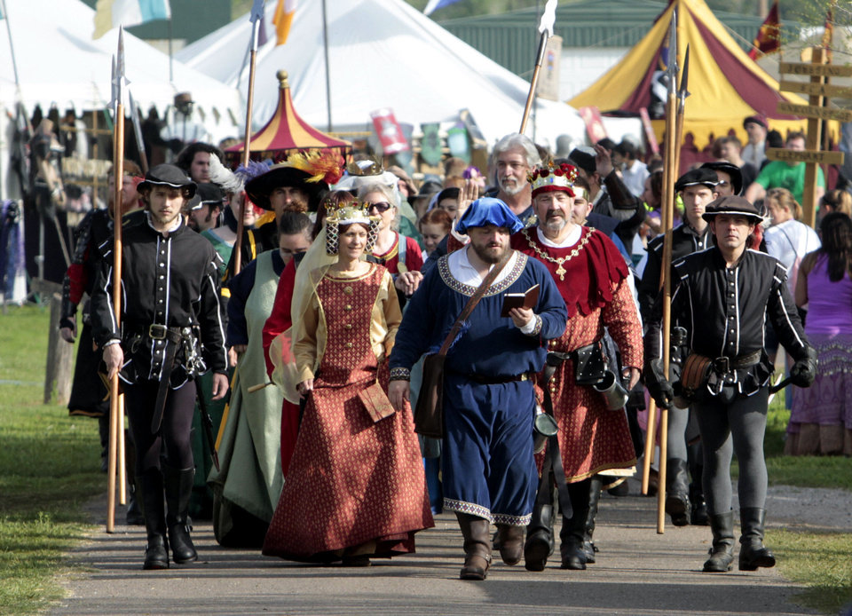 Photo - The Royal Court makes its inaugural procession to the throne during Medieval Fair on Friday, March 30, 2012, in Norman, Okla.  Photo by Steve Sisney, The Oklahoman