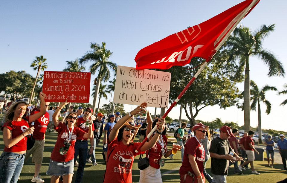 OU fans cheer for their team outside the stadium before the BCS National Championship college football game between the University of Oklahoma Sooners (OU) and the University of Florida Gators (UF) on Thursday, Jan. 8, 2009, at Dolphin Stadium in Miami Gardens, Fla. PHOTO BY BRYAN TERRY, THE OKLAHOMAN