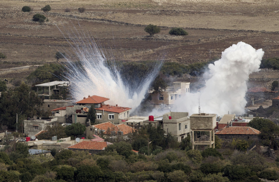 Smoke rises after shells fired by the Syrian army explode in the Syrian village of Bariqa, Monday, Nov. 12, 2012. The Israeli military says