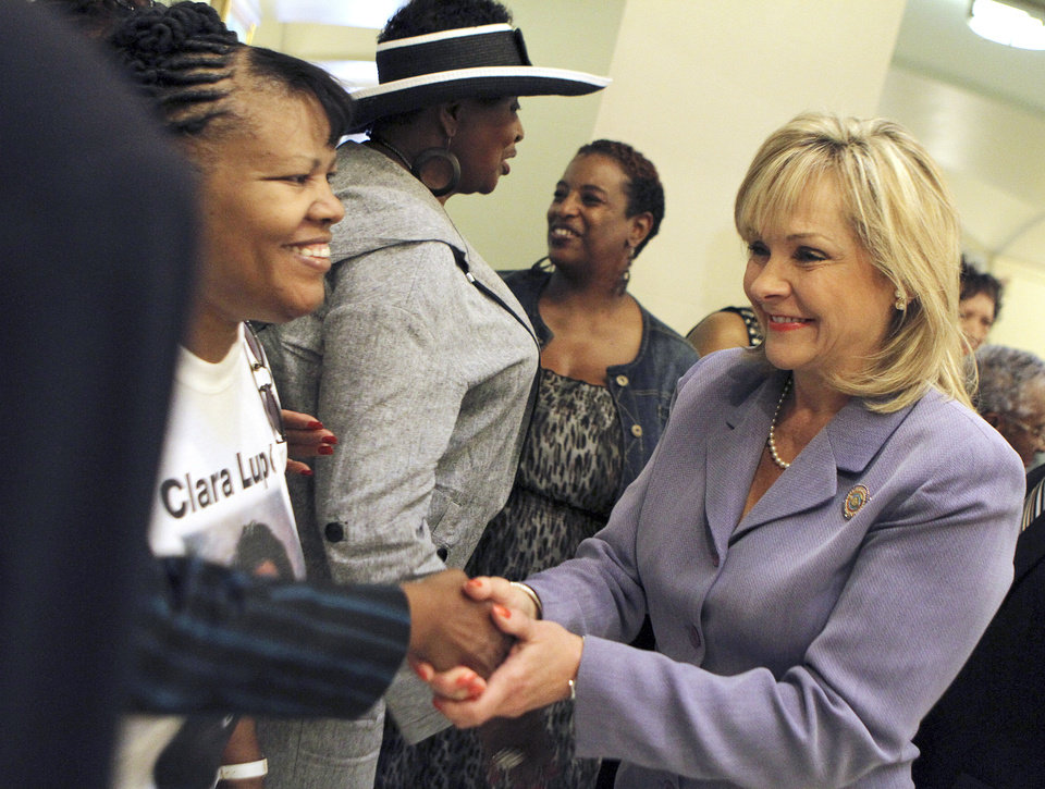 Photo - Governor Mary Fallin shakes the hands of friends and family members of Clara Luper, who lies in repose at the Oklahoma State Capitol in Oklahoma City, June 16, 2011. Photo by Garett Fisbeck, The Oklahoman