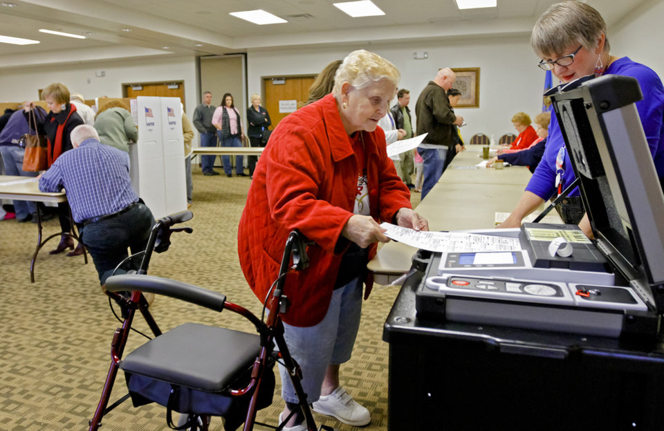 Volunteer Vicki Newby looks on as Phyrne Kendall cast her vote during election day on Tuesday, Nov. 6, 2012, in Yukon, Oklahoma. Photo by Chris Landsberger, The Oklahoman