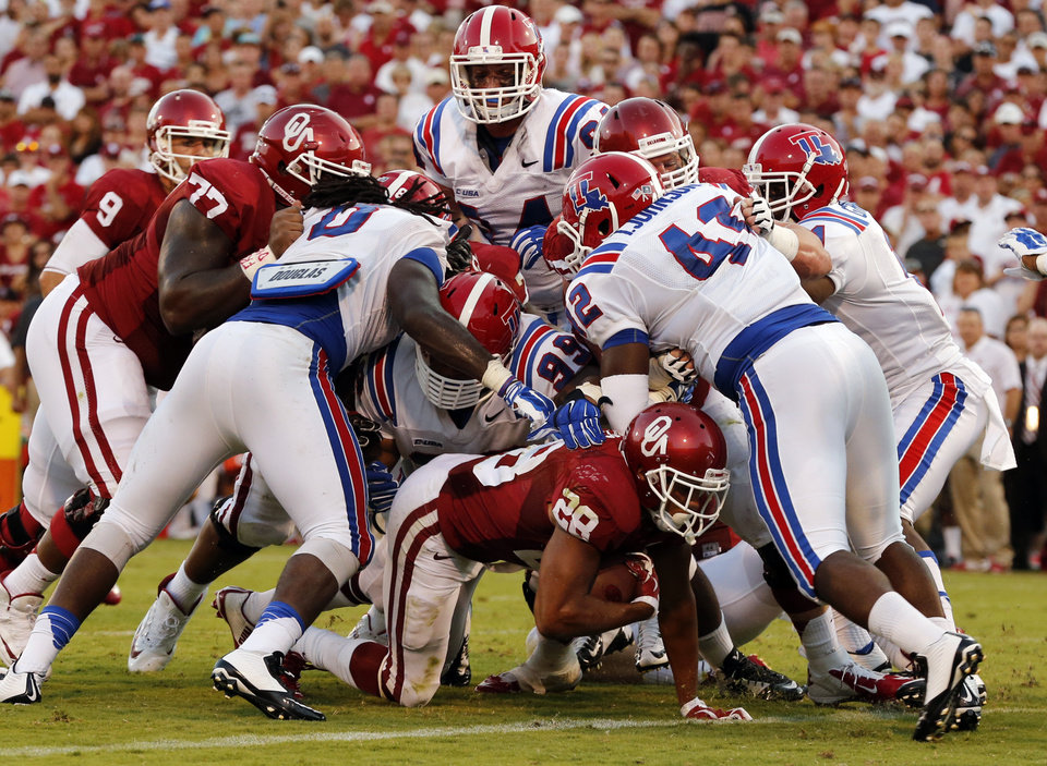 Photo - Oklahoma Sooners's Alex Ross (28) is credited with a score on this run during a college football game between the University of Oklahoma Sooners (OU) and the Louisiana Tech Bulldogs at Gaylord Family-Oklahoma Memorial Stadium in Norman, Okla., on Saturday, Aug. 30, 2014. Photo by Steve Sisney, The Oklahoman