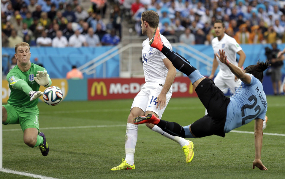 Photo - England's goalkeeper Joe Hart makes a save on a kick by Uruguay's Martin Caceres during the group D World Cup soccer match between Uruguay and England at the Itaquerao Stadium in Sao Paulo, Brazil, Thursday, June 19, 2014.  (AP Photo/Felipe Dana)