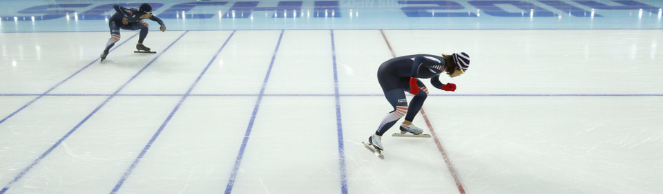 Photo - South Korean speedskaters Lee Kyou-hyuk, rear left, and Lee Sang-hwa practice their start during a training session at the Adler Arena Skating Center during the 2014 Winter Olympics in Sochi, Russia, Friday, Feb. 7, 2014. (AP Photo/Pavel Golovkin)