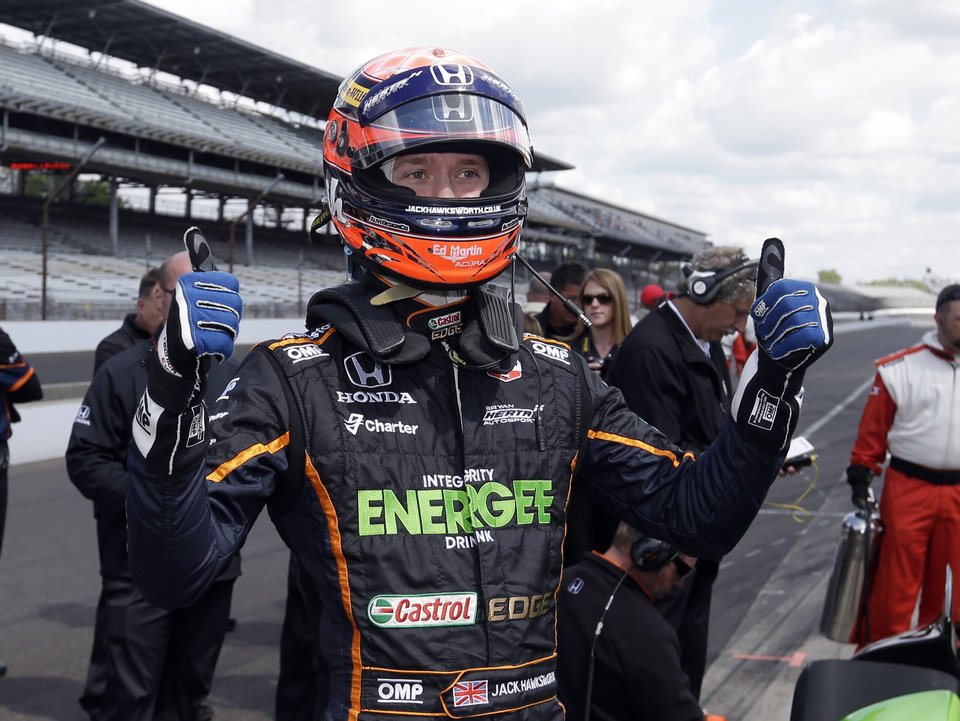 Photo - Jack Hawksworth, of England, signals his pleasure with his speed after he qualified on the first day of qualifications for Indianapolis 500 IndyCar auto race at the Indianapolis Motor Speedway in Indianapolis, Saturday, May 17, 2014. (AP Photo/Darron Cummings)