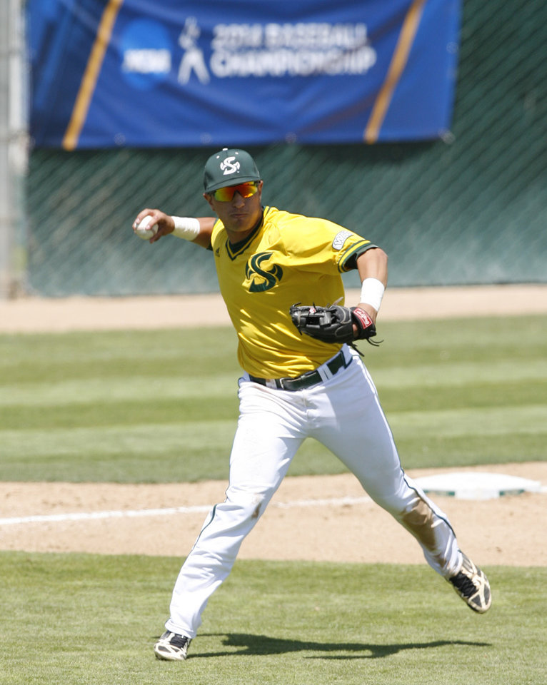 Photo - Sacramento State third baseman Will Soto throws a runner out at first base during the sixth inning of an NCAA college baseball tournament regional game against Arizona State on Saturday, May 31, 2014, in San Luis Obispo, Calif. (AP Photo/Aaron Lambert)