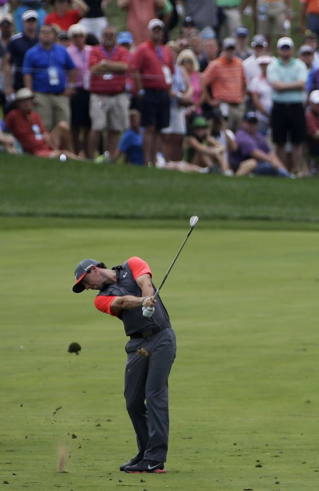Photo - Rory McIlroy, of Northern Ireland, hits from the fairway on the first hole during the first round of the PGA Championship golf tournament at Valhalla Golf Club on Thursday, Aug. 7, 2014, in Louisville, Ky. (AP Photo/David J. Phillip)